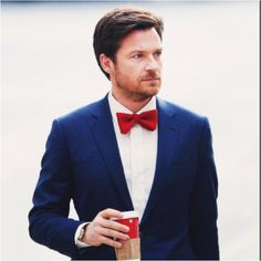 If you go with black-tie optional, here is an idea for red bowtie, blue suit.