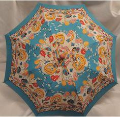 Child's whimsical cotton print umbrella. $25.00, via Etsy.