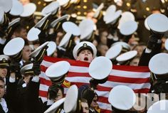 Navy Midshipmen cheer against Army during the first half of the annual Army versus Navy rivalry football game at M&T Bank Stadium in…