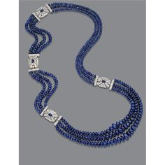 TRIPLE-STRAND SAPPHIRE BEAD AND DIAMOND NECKLACE. Composed of 549 sapphire beads measuring approximately 12.9 to 4.5 mm., arranged in three-row segments, connected by four pierced buckle ornaments set with round and baguette diamonds weighing approximately 3.80 carats, each centering an oval cabochon sapphire, mounted in 18 karat white gold, total length approximately 29 inches, separates into four segments.