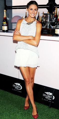Olivia Palermo- at the Moet & Chandon Tiny Tennis Invitational in a white ensemble, statement necklace and red flats.