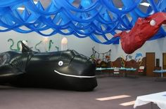 Large scale decorations for story of Jonah and the giant fish. Fabric draped ceiling vbs-ideas-ocean-or-beach-theme