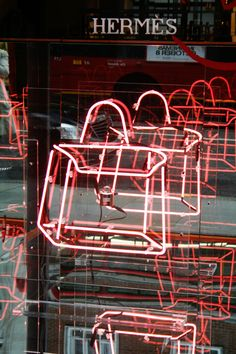 Hermes, Bond Street. Fluorescent light is used together with mirrors to create repeated reflections.