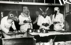 Mardi Gras in a restaurant in Bayern, the waiters are wearing masks. München, Germany, 1933.