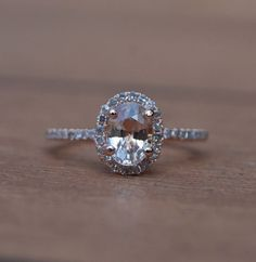 love my engagement ring!  Peach Champagne sapphire with rose gold..