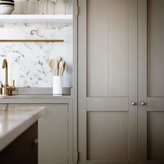Greige kitchen with marble...