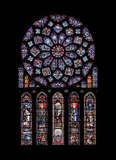 The north transept rose of Chartres Cathedral donated by Blanche of Castile. It represents the Virgin Mary as Queen of Heaven, surrounded by Biblical kings and prophets. Below is St Anne, mother of the Virgin, with four righteous leaders. The window includes the arms of France and Castile.