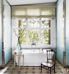 Isabel López-Quesada's Elegant Villa  In a leafy Madrid neighborhood, the decorator converts a former wax factory into a graceful home and work space  Text by Mitchell Owens/Photography by Simon Watson   Produced by Howard Christian      Read more: http://www.architecturaldigest.com/homes/homes/2012/04/isabel-lopez-quesada-madrid-villa-slideshow#ixzz1pFDoL5GN  The sun-dappled master bath features a Water Monopoly tub with fittings by THG.