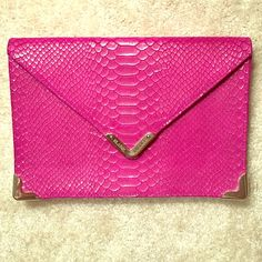 Genuine Oversized Elaine Turner envelope clutch Gorgeous deep magenta with gold shimmer envelope clutch. Clutch has a snake skin pattern on outside and 3 functional pockets on inside. Classy and chic with a touch of glam. Fabulous clutch! Never been used! Elaine Turner Bags Clutches & Wristlets