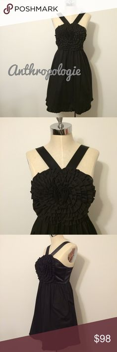 Anthropologie little black dress Unique little black dress by Burlapp for Anthropologie.  Great large floral detail at bust.  Cotton and satin. Size zip closure and has pockets as well. Dry cleaning tag attached.  Great condition. Anthropologie Dresses