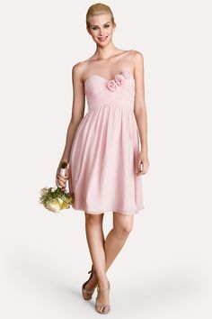 Rosettes accent the sweetheart bodice of this  flirty blush chiffon  dress.