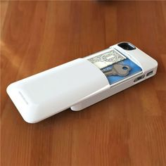 Wish #52 This iPhone case allows you to carry along important small objects.  The case slides off for a little secret compartment that is able to hold money, keys and credit cards.  (Anna Cardamon)