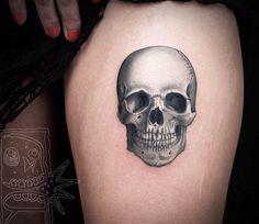 Skull tattoo by Chris Rigoni