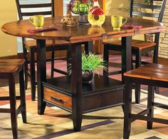 The Steve Silver Abaco Counter Height Dining Table with Storage is one extremely functional furnishing. This tall table features a table top with drop. Dining Table With Storage, Dining Room Bar, A Table, Dining Tables, Kitchen Tables, Round Dining, Kitchen Storage, Patio Bar Set, Pub Table Sets