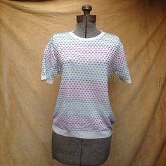 """Vintage 1980s Women's Short Sleeve Pastel Sweater, Basketweave. Small. Cute short sleeve pastel sweater with a scoop neck.  Details Size: Petite Small Chest: 36"""" Shoulders: 15"""" Sleeve: 8"""" Length: 23"""" Waist: 34""""  Label: Alfred Dunner, Petite Small, 100% acrylic, made in USA Colors: white, pink, pale blue, lavender, mauve, raspberry"""