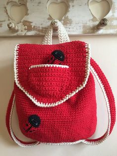 LoveCrochet |  How cute is this backpack? Kate Eastwood has created a miniature version of her gorgeous backpack for the little people in your life! Ladybird, Ladybug, fly away home!  Following on fro