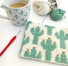 Cactus Zipper Pouch Cactus Zipper Pouch The Cactus Zipper pouch is crocheted using the modified single crochet stitch for tapestry crochet which creates straight vertical lines of stitches. You can learn how to do th… Tapestry Crochet Patterns, Crochet Purse Patterns, Crochet Pouch, Crochet Diy, Tunisian Crochet, Crochet Purses, Crochet Gifts, Crochet Stitches, Cactus En Crochet