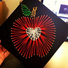 string art apple graduation cap. Just stick the tiny nails right into your cap (there's cardboard inside) and string with embroidery floss.