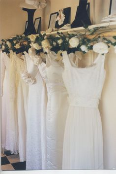 wedding dress shops   Amy-jo-tatum-bridal-couture-wedding-dresses-hang-on-rack-lace-applique ...