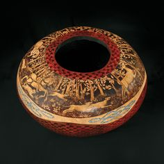 Jenn Avery burns exquisite designs on gourds.