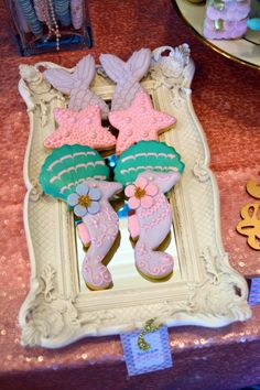 A LITTLE MERMAID sugar cookies with mermaid tails, starfish, shells and sea horses.