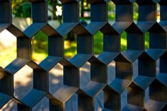Steel honeycomb fencing adds style and strong security to an outdoor space without creating an insular, closed-in feel.