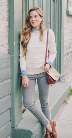 Girlmeetsglam.. love this fall outfit! The denim shirt peeking out over a chunky sweater, with skinny jeans and some good fall colored loafers
