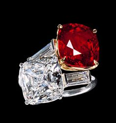 Platinum ring, the shoulders terminating in baguette cut diamonds supporting the bezel set with a square cut diamond and a ruby, Cartier c. 1950