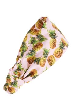 Keeping the hair back with this cute pineapple printed  head wrap.