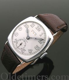 A large silver cushion vintage Longines watch, 1920s