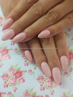 Pastel pink gel polish over almond acrylic nails