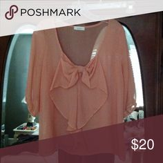 Peachy orange blouse EUC (only worn a few times) peachy orange blouse with cute bow front detail - size small but fits a little loose, purchased from local boutique Tops Blouses