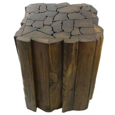 $106.99  This beautifully handcrafted piece can be enjoyed as an accent table or a stool. The artisans attach many small pieces of recycled teak together, giving this table its unique and beautiful jigsaw look.