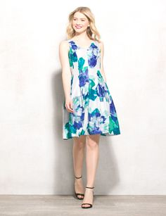 It's officially floral season, so we couldn't think of anything more appropriate for the warmer months ahead than a flirty, flower-filled dress like this one. Allover white, blue and green floral print. Imported.