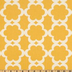 Designed by Dena Designs for Free Spirit Fabrics, this cotton print features a fuchsia floral within a white floral on a yellow background.  Use for quilting and craft projects.