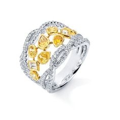 COLORED DIAMOND JEWELRY  Over $10,000  Reverie Collection gold band with 2.14 cts. t.w. white and natural color diamonds; $12,075; Parade Design