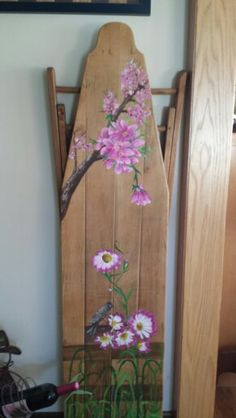 Paint a picture on an old wooden ironing board. Love it!!!