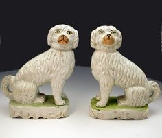 PAIR STAFFORDSHIRE FIGURES OF PIPE SMOKING DOGS