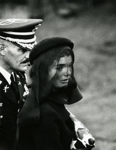 Jackie Kennedy at the funeral of JFK. As so many I remember where I was when JFK was assassinated. As a kid I wrote to the Jackie and received a note back (who knows how many of those went out. Jackie Kennedy, Les Kennedy, Carolyn Bessette Kennedy, Jaqueline Kennedy, American Presidents, American History, Grace Kelly, Le Clan, Kennedy Assassination