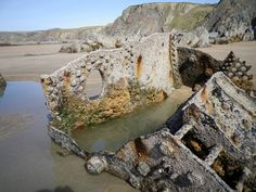 "Northcott Beach, Bude, N Cornwall, UK. Remains of 1925 ton Portuguese steamship ""Belem"" (former German SS Rhodos) stranded in fog 20 Nov 1917 going Gibraltar to Barry. 33 crew inc 2 Royal Navy gunners (armed with light gun aft) brought ashore by rocket apparatus. Soon broke up & total loss for scrap only. Remains only seen after heavy seas remove sand, In 1980s enthusiasts recovered her propeller shaft - donated to Bude Museum. Another part holds barrel on Barrel Rock at end of Bude…"