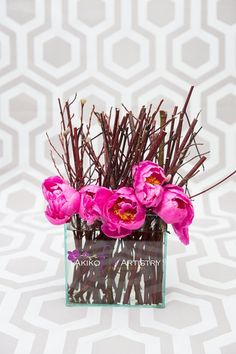 Vibrant pink peonies mixed with twigs   Floral design by http://akikofloral.com