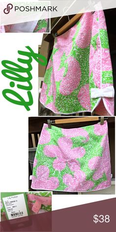 """LIMEADE Cosette Skort Skirt Short w/ Bows and Trim Makes me want a tall glass of lemonade! Look adorable and dare to show those legs with no fear of wardrobe malfunction! Vivid green and pink on a white background makes this piece pop! NWT, tagged size 6. Waist 16"""" flat, Length 15"""". Cotton/spandex. Please ask all questions prior to purchase. Lilly Pulitzer Skirts Mini"""