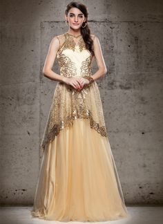 This cream net floor length gown is adding the desirable glamorous showing the sense of cute and graceful. Beautified with cutdana, kasab and resham work all synchronized very well with all the trend ...