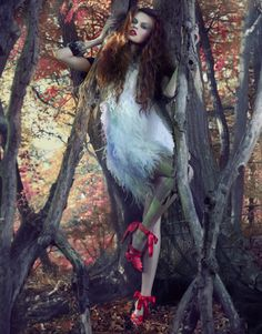 aside from the atrocious shoes/outfit -- I love this pose --- intertwined with nature would be good for both models?---It is suppose to be the Fairytale 'The Red Shoes' I love this!