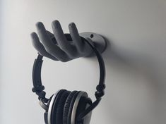 Check out this item in my Etsy shop https://www.etsy.com/uk/listing/499988180/wall-mounted-hand-holder-for-headphones