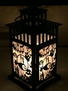 Beautifully upcycled portable lantern inspired by the Nightmare Before Christmas. Featuring one of a kind laminated handcut cardstock and frosted paper displayed in a 11 inch tall metal craft lantern. This item is 100 percent customizable and can be made in any theme you desire. Please contact shop owner with any special requests or questions. LANTERN IS LIT BY CANDLELIGHT. CANDLE NOT INCLUDED. Lanterns are available in black or white All items have a 4-6 week production time. If item is…