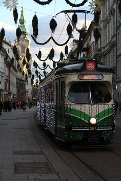 Sarah J. Loecker : A christmas walk- A liesurly walk through Graz Austria on Christmas afternoon. The streets are empty and the christmas lights sparkle in the cold night. Graz Austria, Living In Europe, Cold Night, Christmas Lights, Empty, Walking, Sparkle, Adventure, Street