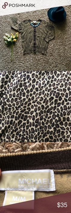 Michael Kors cheetah print cardigan This piece is beautiful! Never worn before and detailed with an on point cheetah pattern! Easily worn dresses up or down and extremely comfy! A must have ladies! Michael Kors Sweaters Cardigans