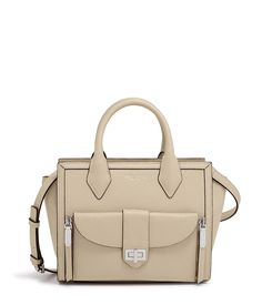 Poised, polished, and petite, the Bendel Girl carrying the Rivington Mini Convertible Tote is the maven of mod. Crafted with sensuously pebbled leather, this luxury handbag is designed to keep your every item organized and easily at hand. The front flap pocket ingeniously detaches to serve as the perfect post-work clutch or crossbody companion.