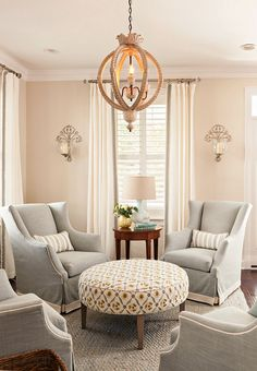 I like the idea of four identical chairs surrounding a large ottoman. It makes a perfect conversation area.